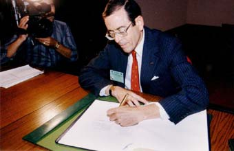 Ambassador Richard Benedick (State Department) signing the Montreal Protocol on behalf of the USA Sept. 16, 1987.