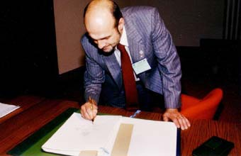 Vic Buxton signing the final Act of the diplomatic Conference in Montreal (ICAO facility) Sept. 16, 1987.