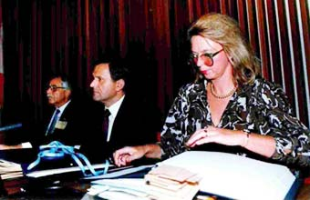 Day of the Signature of Montreal Protocol, Montreal, Canada, 1987. Dr. Iwona Rummel-Bulska, Executive Secretary of the Negotiations on Substances that Deplete the Ozone Layer Protocol with the visible original of the Montreal Protocol with the names of the countries present included. At her right is Prof. Vincent Lang present in the said Conference.