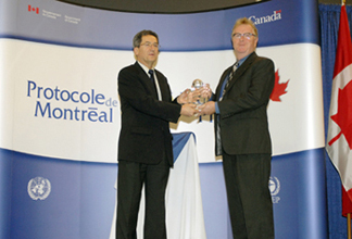 Bruce Cox, Executive Director of Greenpeace Canada, receives the award for Greenpeace International.
